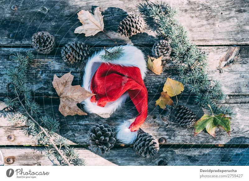 Christmas decoration in a wood table outdoors Christmas & Advent Gift Hat Santa Claus Life Still Life Background picture Decoration
