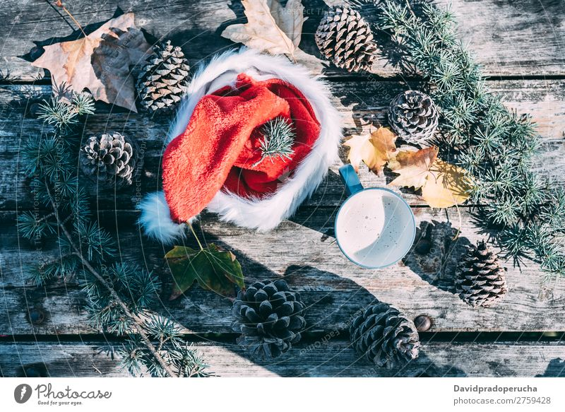 Christmas decoration in a wood table outdoors Christmas & Advent Gift Hat Santa Claus Life Still Life Coffee Hot