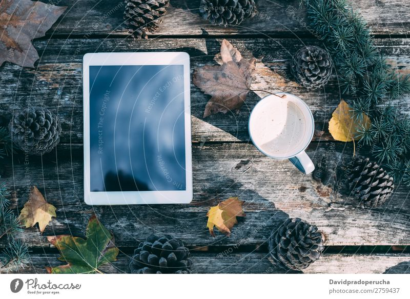 Tablet on a wooden table with coffee and pines outdoor Christmas & Advent Tablet computer Technology Gift Coffee Hot Drinking Modern