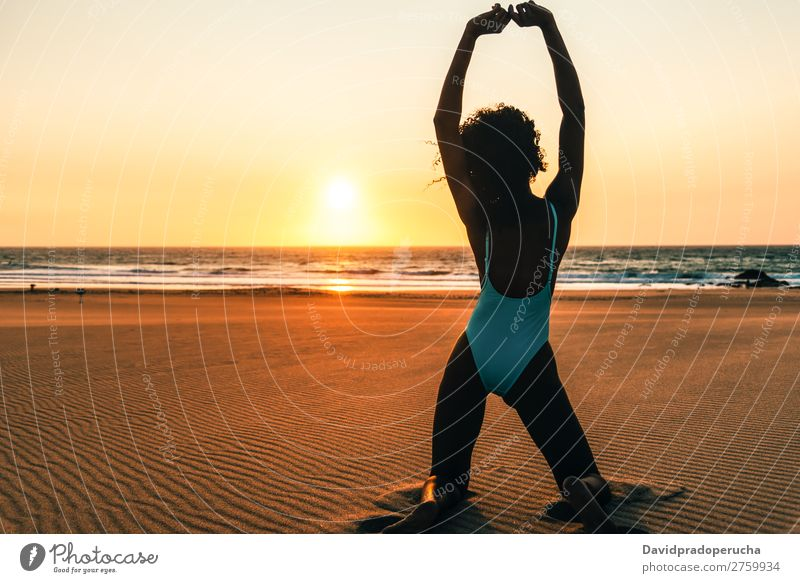 Beautiful young woman posing on the sand at the beach Beach Sand pose Woman Human being Isolated romantic Ocean Sun Vacation & Travel Nature Swimming Suit Joy
