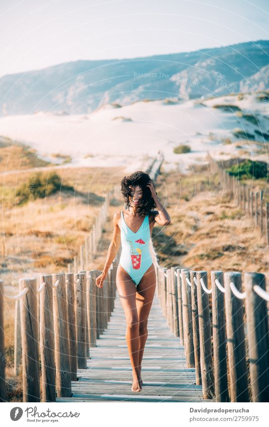 Happy beautiful young woman with a swimming suit running in a wooden foot bridge at the beach Beach Woman Bikini Swimming Suit Black Bridge Background picture