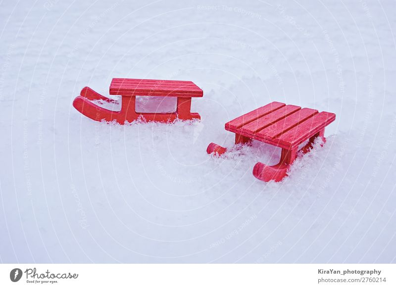 Miniature red sled on white snow Lifestyle Style Design Joy Leisure and hobbies Vacation & Travel Winter Snow Decoration Christmas & Advent Infancy Nature