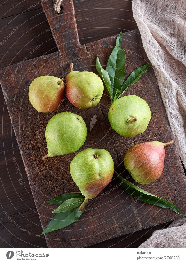 ripe green pears on a brown wooden board Fruit Nutrition Vegetarian diet Diet Table Wood Eating Fresh Delicious Natural Juicy Green agriculture food healthy