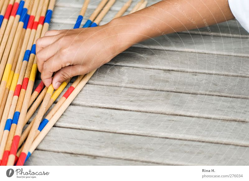 Human being Child Hand Playing Boy (child) Infancy Arm Leisure and hobbies Table Touch Concentrate 3 - 8 years Mikado