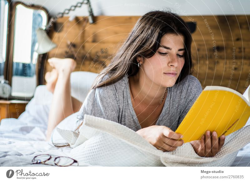 woman laying in bed and reading book Coffee Lifestyle Happy Beautiful Relaxation Leisure and hobbies Reading Winter House (Residential Structure) Bedroom