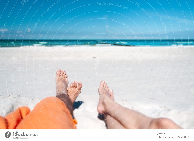 Human being Blue Vacation & Travel Summer Beach Relaxation Far-off places Feminine Coast Happy Couple Horizon Brown Orange Waves Lie