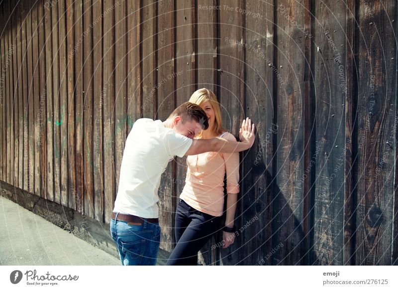 2 Masculine Feminine Young woman Youth (Young adults) Young man Friendship Couple Human being 18 - 30 years Adults Beautiful Laughter Facade Wall (building)