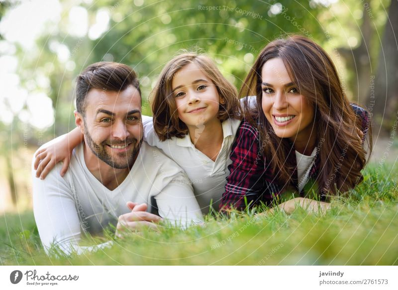 Happy young family in a urban park. Lifestyle Joy Beautiful Summer Child Human being Woman Adults Man Parents Mother Father Family & Relations Infancy 3 Group