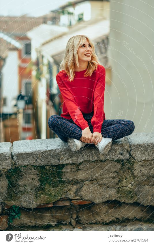 Smiling blonde girl with red shirt enjoying life outdoors. Woman Human being Youth (Young adults) Young woman Beautiful White Red 18 - 30 years Street Lifestyle