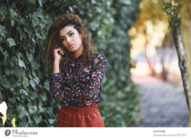 Beautiful young Arab woman with black curly hairstyle. Lifestyle Style Hair and hairstyles Human being Feminine Young woman Youth (Young adults) Woman Adults 1