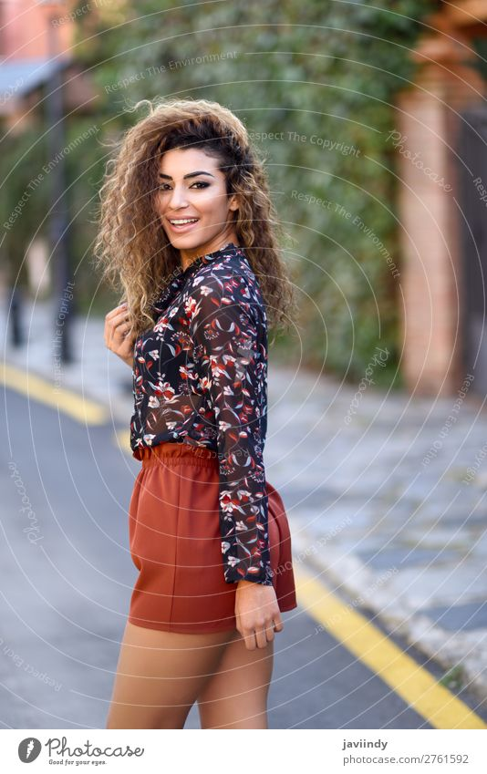 Happy young arabic woman with black curly hairstyle. Woman Human being Youth (Young adults) Young woman Beautiful Red Joy 18 - 30 years Street Lifestyle Adults