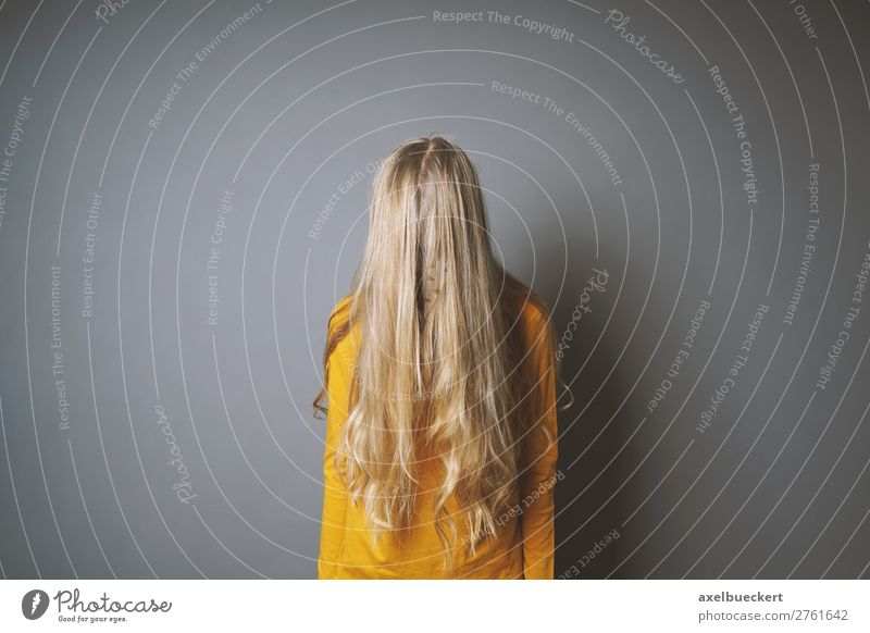 female teenager hides face behind hair Human being Feminine Girl Young woman Youth (Young adults) Woman Adults 1 13 - 18 years Hair and hairstyles Blonde