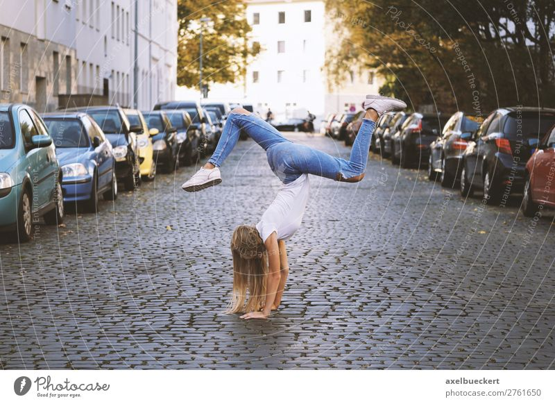 young woman doing handstand in the middle of the street Lifestyle Joy Athletic Leisure and hobbies Sports Fitness Sports Training Yoga Human being Feminine Girl