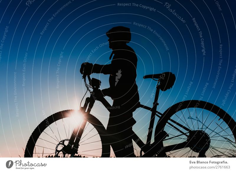 silhouette of a Cyclist Riding Bike at Sunset. Sport Concept. Lifestyle Relaxation Leisure and hobbies Adventure Summer Mountain Sports Cycling Masculine