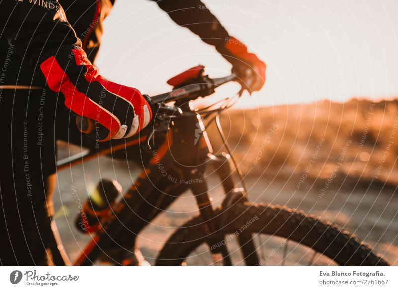 close up Cyclist glove and handlebar.Man Riding Bike.Sports Lifestyle Relaxation Adventure Summer Sun Mountain Cycling Adults Nature Landscape Sky Hill Rock