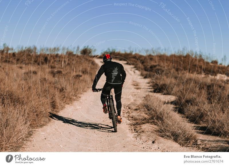 Cyclist Riding the Bike at Sunset. Sport Concept. Human being Sky Nature Youth (Young adults) Man Summer Young man Landscape Red Relaxation Joy Winter Mountain
