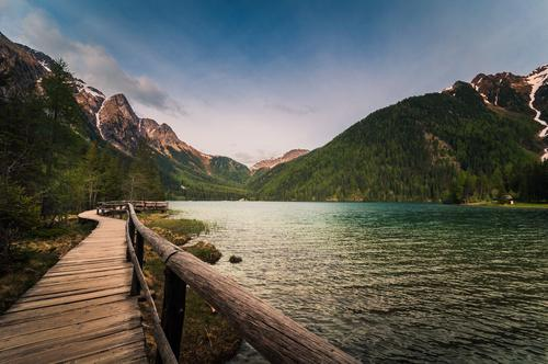 footbridge for hiking, at the lake, with view of the mountains Panorama (View) Deep depth of field Contrast Shadow Light Twilight Evening Day Exterior shot
