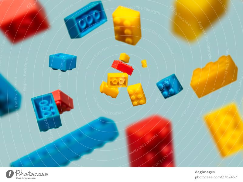 Floating Plastic geometric cubes in the air. Construction toys Design Playing Child Infancy Toys Brick Build Movement Blue Colour blocks falling background rows