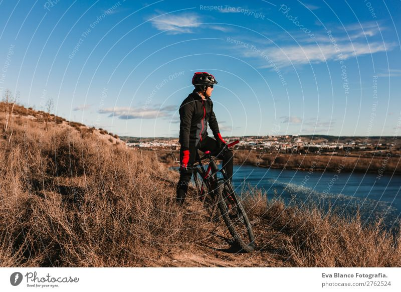 Cyclist Riding a Bike at dunset. Sports Human being Sky Nature Youth (Young adults) Man Summer Blue Young man Landscape Red Sun Relaxation Joy Winter Mountain