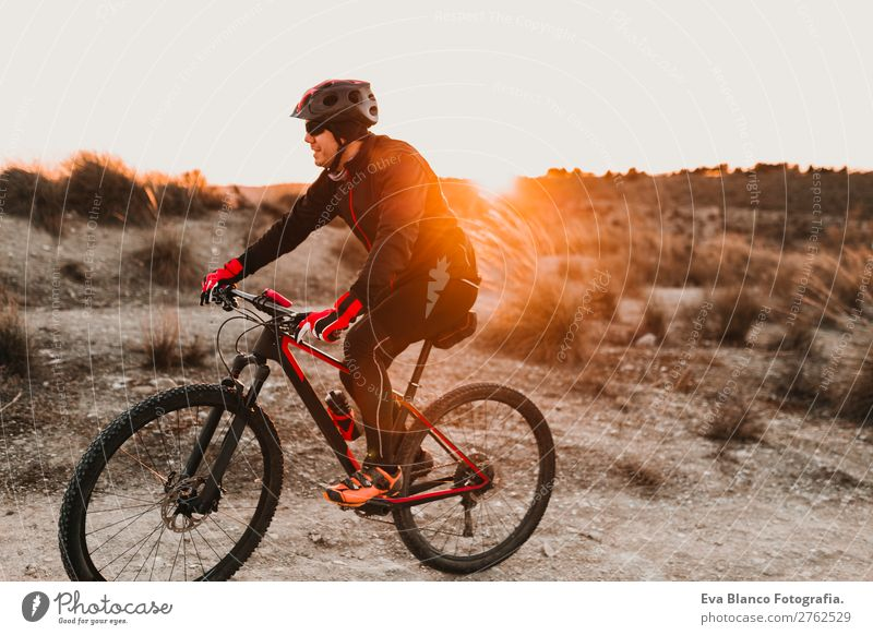 Cyclist Riding a bike at sunset. Sports Human being Sky Nature Youth (Young adults) Man Summer Young man Landscape Red Sun Relaxation Forest Winter Mountain