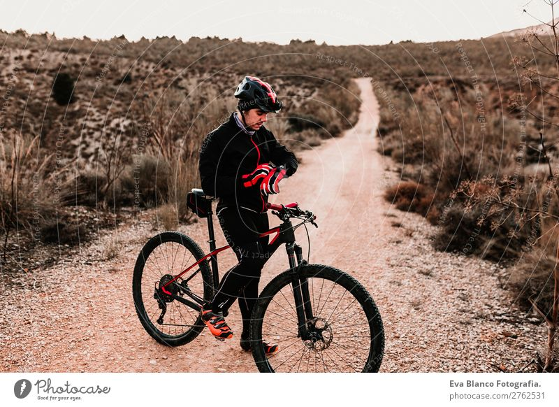 Cyclist Riding a bike at sunset. Sports Human being Sky Nature Youth (Young adults) Man Summer Young man Landscape Red Sun Joy Forest Winter Mountain Black