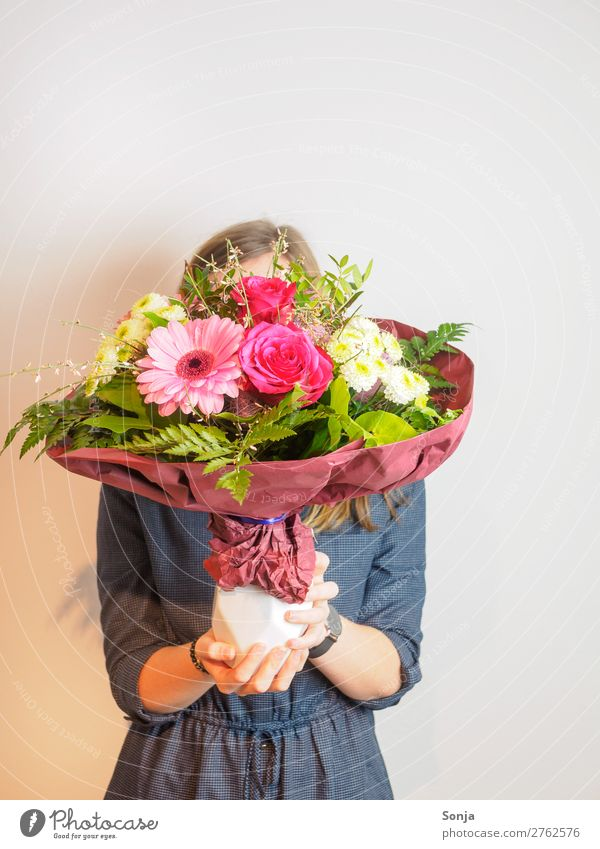 Young woman with a bouquet of flowers in front of her face Lifestyle Style Valentine's Day Mother's Day Birthday Youth (Young adults) Hand 1 Human being