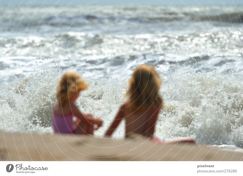 Girl in front of the roaring surf Joy Summer Summer vacation Sun Beach Ocean Waves Human being Feminine Child Brothers and sisters 2 3 - 8 years Infancy Sand