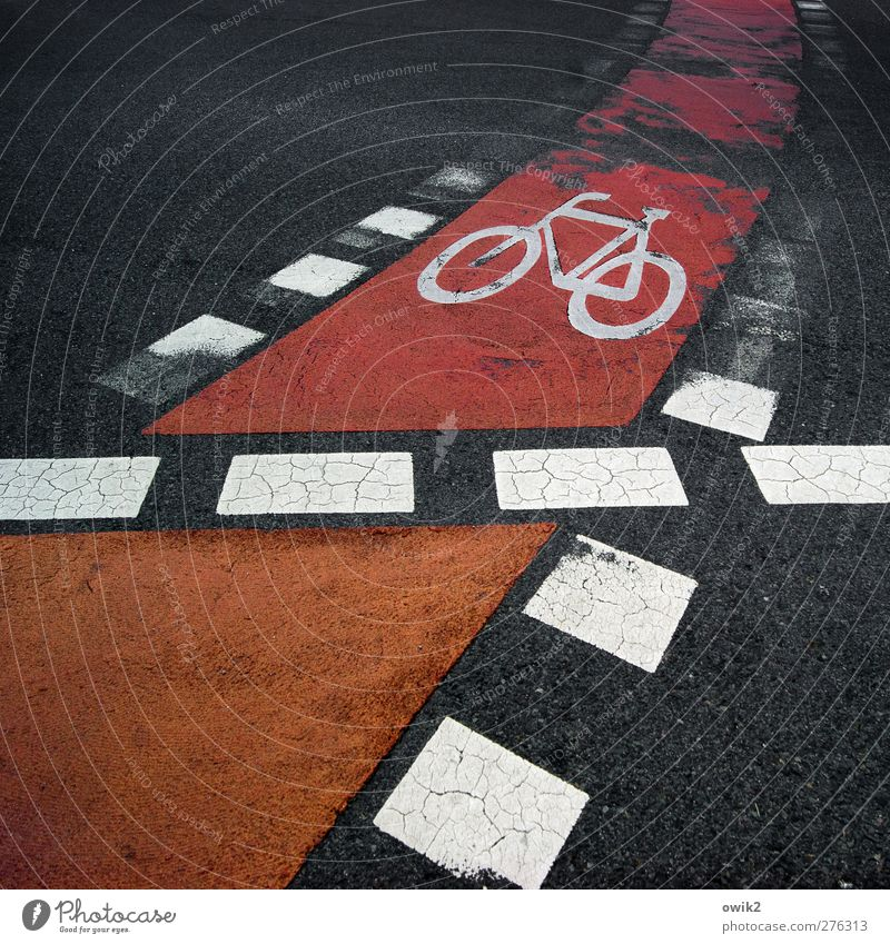 rolling home Transport Traffic infrastructure Street Marker line Cycle path Fat Sharp-edged Town Orange Red Black White Symbols and metaphors Bicycle