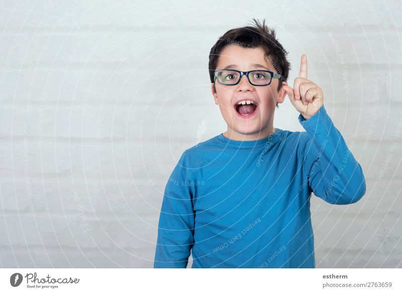 boy in glasses pointing finger up Lifestyle Joy Education Child School Schoolchild Student To talk Human being Masculine Boy (child) Infancy Fingers 1