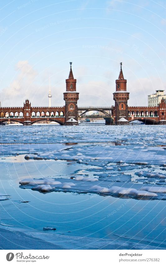 In winter the sun shone in Berlin recently. Winter Capital city Bridge Architecture Landmark Oberbaumbrücke Traffic infrastructure Inland navigation Famousness