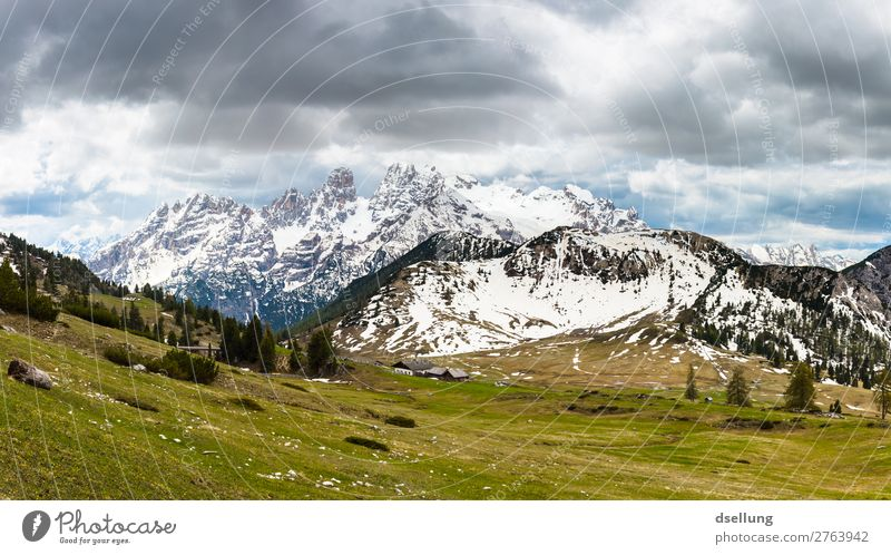 Snow-covered mountain peaks with cloudy sky Sunlight Picturesque Multicoloured Europe Climate Elements Tourism Clouds wide Large Tall Firm Gigantic Italy