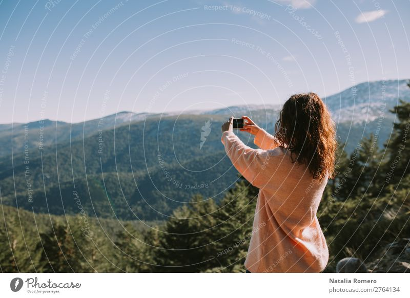 a girl takes a picture of the mountains Woman Human being Sky Vacation & Travel Nature Summer Beautiful Green Landscape Tree Mountain Lifestyle Adults Autumn