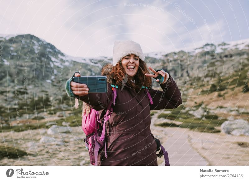brunette girl with her backpack she takes a picture Lifestyle Happy Vacation & Travel Tourism Trip Adventure Freedom Mountain Telephone Camera Human being Woman