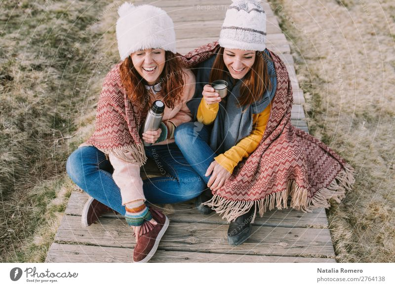 two friends have a fit of laughter while drinking broth Coffee Tea Lifestyle Style Joy Happy Beautiful Relaxation Leisure and hobbies Vacation & Travel Sun
