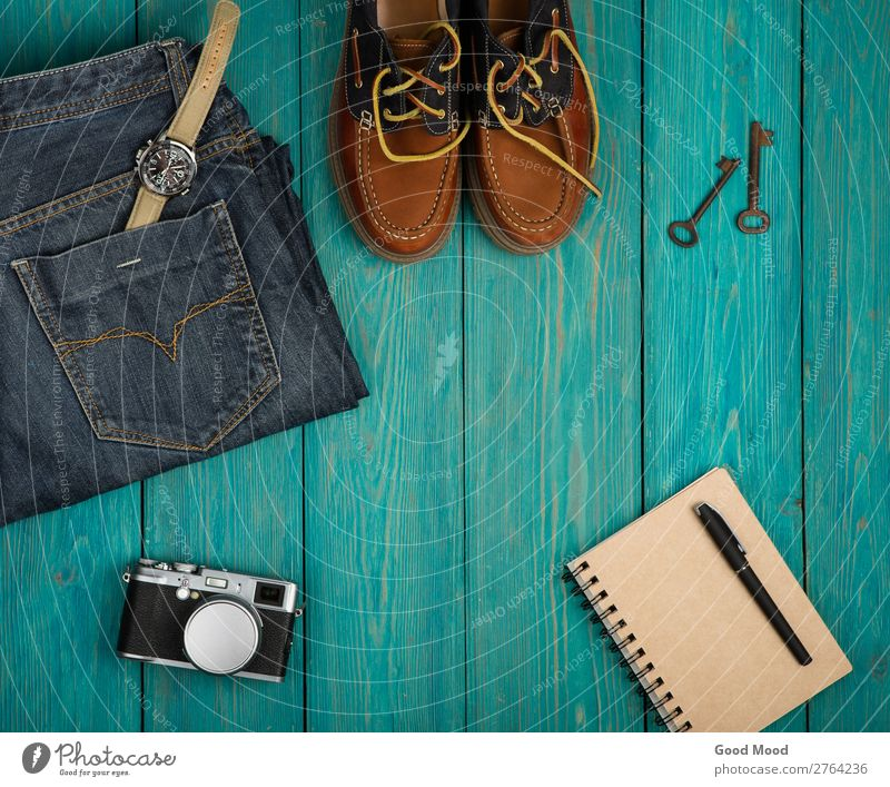 Travel concept - shoes, jeans, notepad, camera Vacation & Travel Blue Wood Fashion Trip Retro Vantage point Table Footwear Clothing Things Camera Pants Jeans