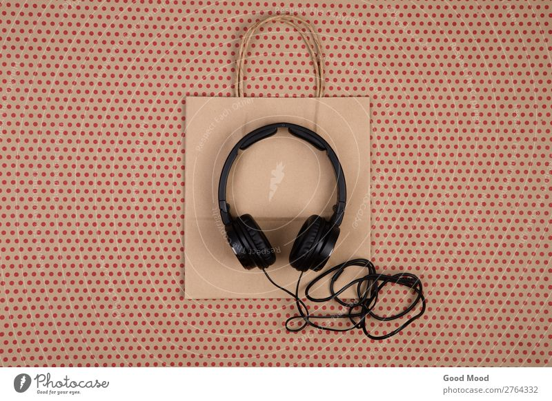 black headphones and shopping bag Natural Business Vantage point Music Technology Gift Shopping Paper Circle Telephone New Point Listening Digital Craft (trade)