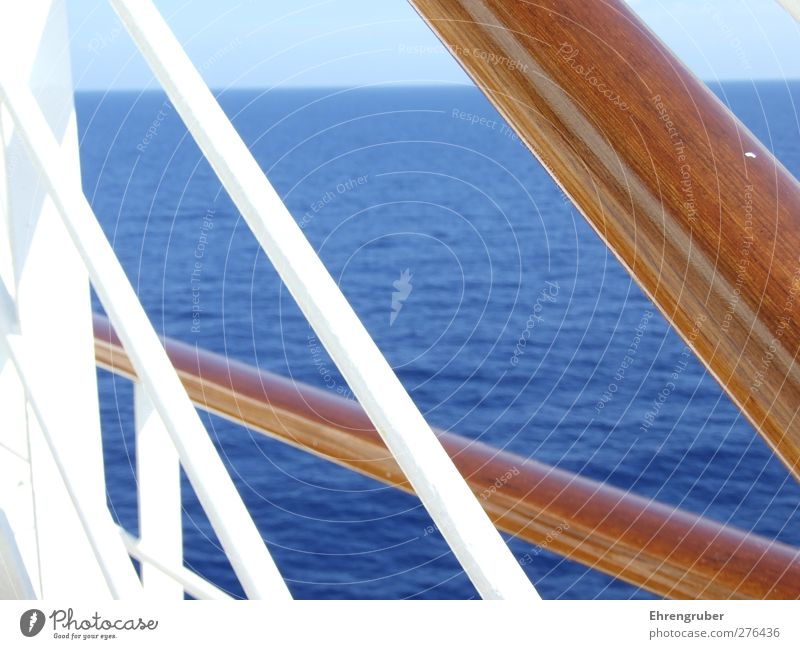 Wood, steel and sea Cruise Ocean Navigation Passenger ship Cruise liner Relaxation Blue Brown Wanderlust Colour photo Exterior shot Deserted Day Sunlight
