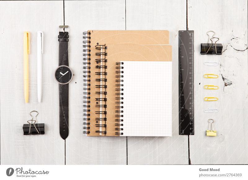 Workplace with notepad, watch, other office supply Reading Desk Table Work and employment Office Business Paper Pen Wood Line Observe Write Above White