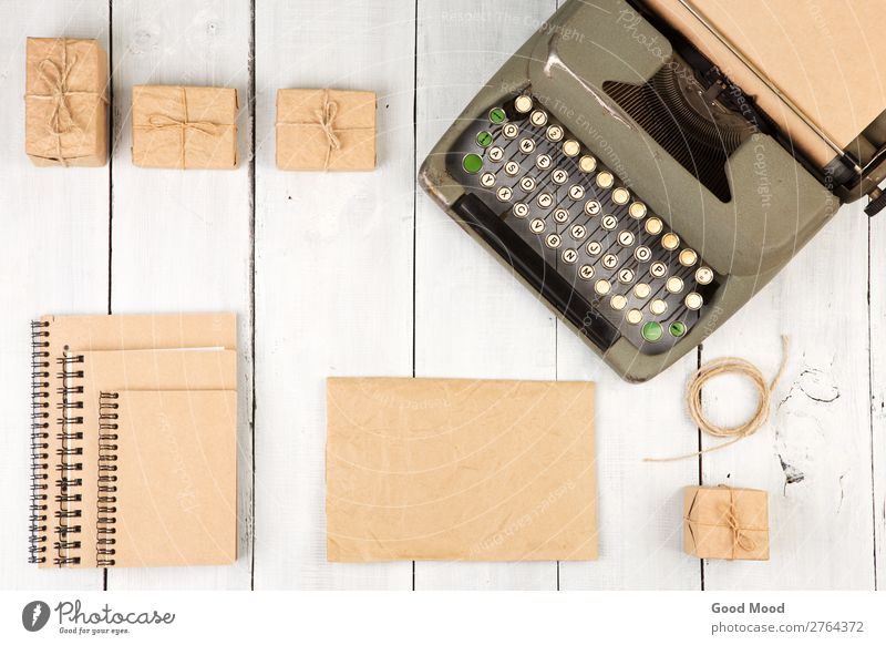 vintage typewriter, notepads, present boxes Desk Table Office Craft (trade) Business Rope Book Paper Pen Wood Old Above Retro White Typewriter Top Vantage point