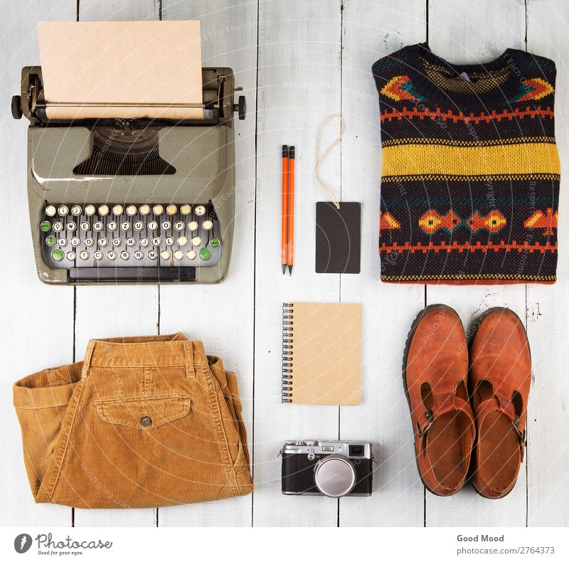 typewriter, notepad, camera, clothes and shoes Reading Vacation & Travel Trip Table Camera Clothing Pants Jeans Sweater Leather Accessory Footwear Boots Pack