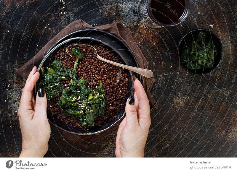 Black lentils and vegetables stew Vegetable Vegetarian diet Plate Spoon Hand Dark Above Lentils legumes Beluga Spinach Vegan diet eat food garnish healthy