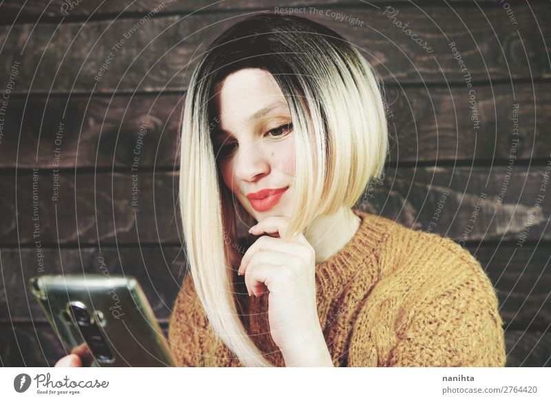 Blonde woman using her mobile phone Lifestyle Elegant Hair and hairstyles Work and employment Business Telephone Cellphone PDA Technology