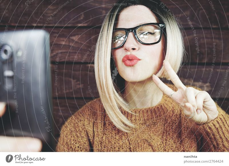 Blonde woman using her mobile phone Woman Human being Youth (Young adults) Young woman Beautiful Joy 18 - 30 years Lifestyle Adults Natural Feminine Business