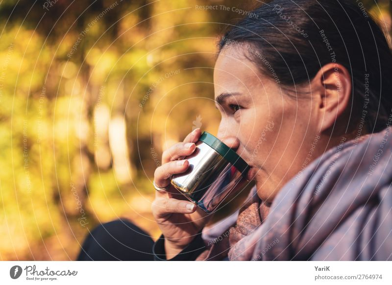 warm sip Feminine Young woman Youth (Young adults) Woman Adults Head 1 Human being Nature Sun Autumn Beautiful weather Forest Warmth Drinking Cup Bavaria Heat