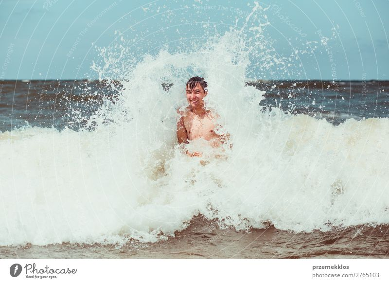 Young man enjoying the high waves in the sea Lifestyle Joy Happy Relaxation Leisure and hobbies Playing Vacation & Travel Summer Beach Ocean Human being