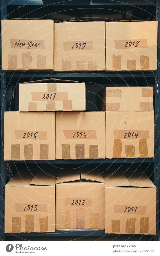 Cardboard boxes labeled number of years on shelves File Packaging Package Large Historic New Brown archive Carton depository distribution equipment many Order
