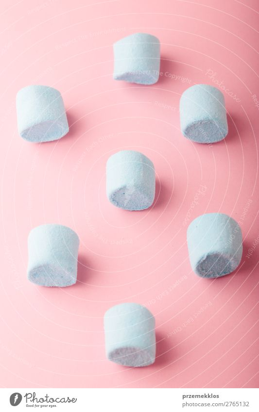 Blue marshmallows on plain pink background Dessert Candy Nutrition Eating Diet Design Table Bright Delicious Pink Colour Creativity colorful flat food isolated