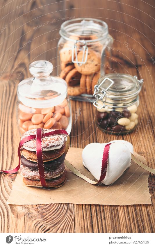 Gingerbread cookies, candies, cakes in jars on wooden table Cake Dessert Candy Nutrition Eating Diet Lifestyle Table Heart To enjoy Delicious Brown Baking