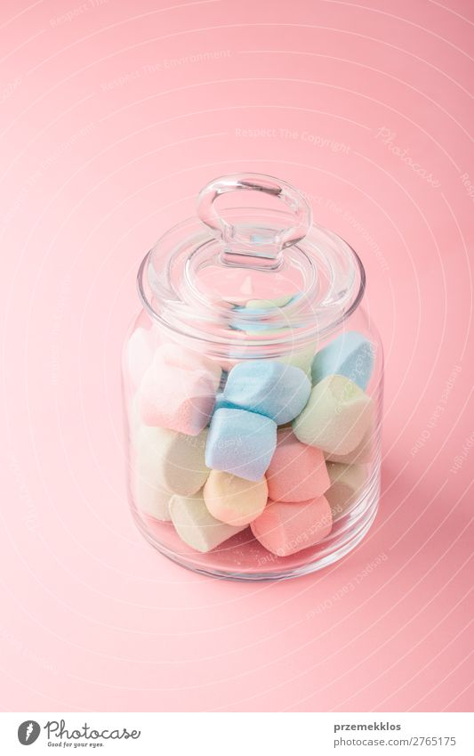 Jar filled with colorful marshmallows on plain background Dessert Candy Nutrition Eating Diet Bright Delicious Blue Colour eat food isolated jar pastel Plain