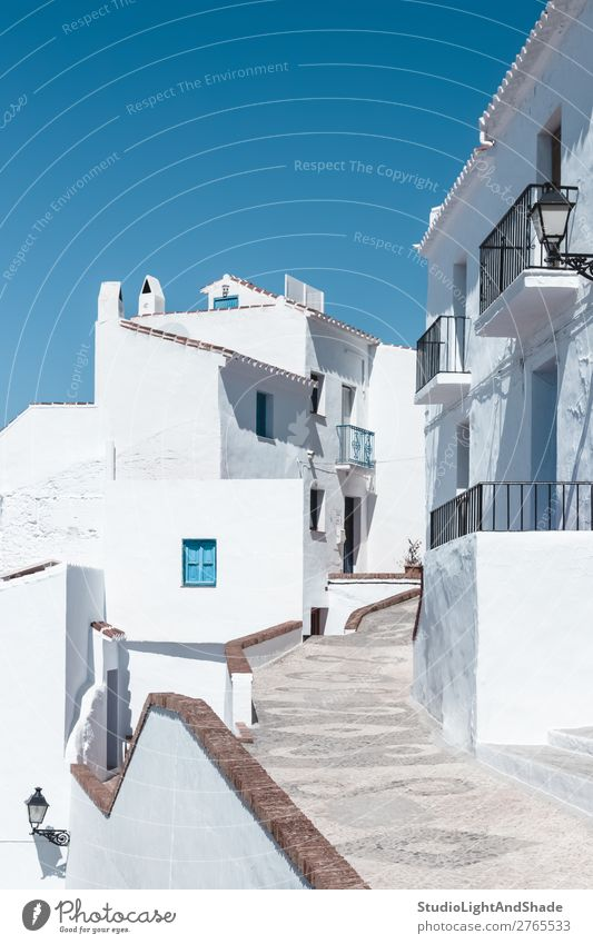 Street with white houses under blue sky Vacation & Travel House (Residential Structure) Sky Town Building Architecture Facade Balcony Blue White Colour